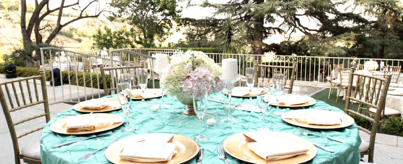Outside dining area with teal table settingss
