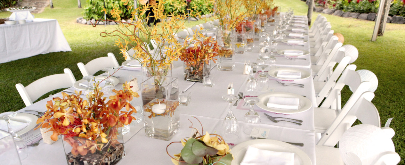 Outside dining area with long table setting