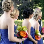 bridesmaids holding bouquet facing forward