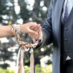 rope tired around couples hands