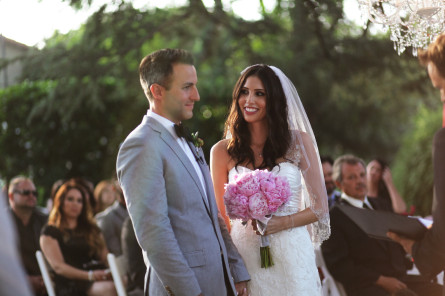 couple reciting wedding vowels outdoors