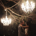 couple kissing under lights