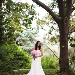 bride outdoors holding bouquet