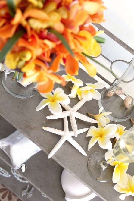 display with yellow flowers and starfish