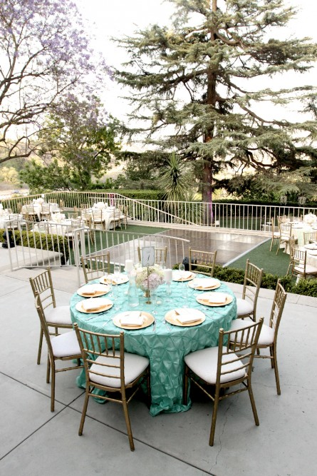 Kellogg House - upper level setup with teal cloth and gold chairs