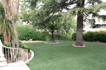 Kellogg House lower level with trees and green yard